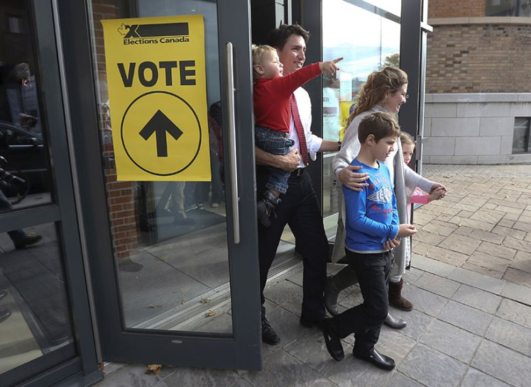 Liberal leader Trudeau leaves the polling station with his wife Sophie, sons Hadrien, Xavier and daughter Ella-Grace after voting in Montreal